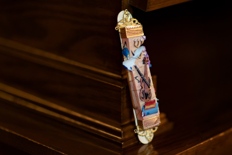 """<a href=""""http://filesource.abacast.com/commonwealthofpa/photo/17406_GOV_Poland_Lithuania_NK_005.JPG"""" target=""""_blank"""">⇣Download Photo<br></a>A mezuzah damaged at the Tree of Life shooting is pictured inside the Governor's Reception Room at the State Capitol building in Harrisburg on Friday, September 6, 2019. Governor Tom Wolf will carry the mezuzah on his trip abroad to the Paneriai memorial in Lithuania and Auschwitz-Birkenau in Poland."""