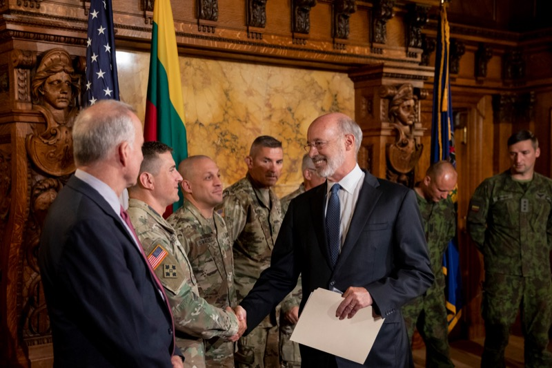 """<a href=""""http://filesource.abacast.com/commonwealthofpa/photo/17406_GOV_Poland_Lithuania_NK_007.JPG"""" target=""""_blank"""">⇣Download Photo<br></a>Governor Tom Wolf shakes hands with Sgt. First Class John Nebzydoski, of the Pennsylvania Army National Guard, before outlining his plans for a trip to Lithuania and Poland inside the Governor's Reception Room at the State Capitol building in Harrisburg on Friday, September 6, 2019."""