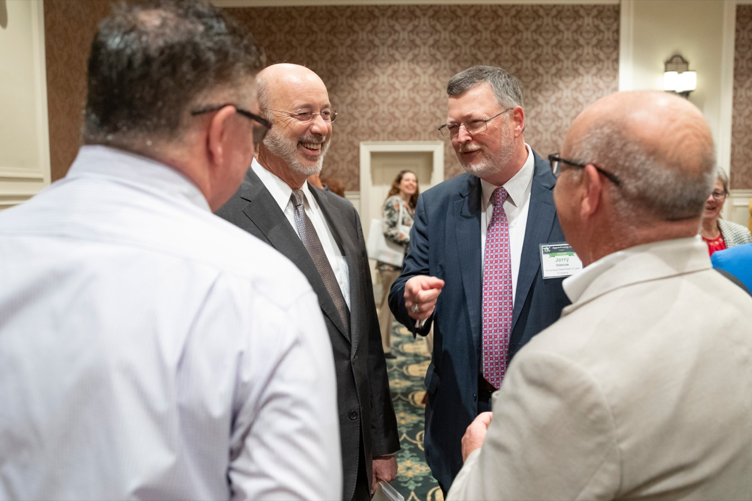 "<a href=""http://filesource.abacast.com/commonwealthofpa/photo/17520_LandI_Apprenticeships_NK_001.JPG"" target=""_blank"">⇣ Download Photo<br></a>Pennsylvania Governor Tom Wolf smiles with Jerry Oleksiak, secretary for Pennsylvania department of Labor and Industry, during the 2019 Pennsylvania Apprenticeship Summit at Hershey Lodge on Thursday, October 31, 2019."