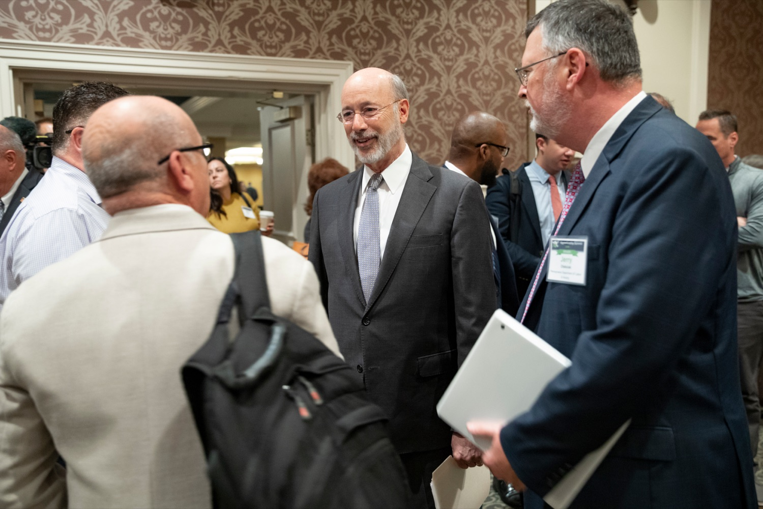 "<a href=""http://filesource.abacast.com/commonwealthofpa/photo/17520_LandI_Apprenticeships_NK_004.JPG"" target=""_blank"">⇣ Download Photo<br></a>Pennsylvania Governor Tom Wolf smiles with Jerry Oleksiak, secretary for Pennsylvania department of Labor and Industry, during the 2019 Pennsylvania Apprenticeship Summit at Hershey Lodge on Thursday, October 31, 2019."