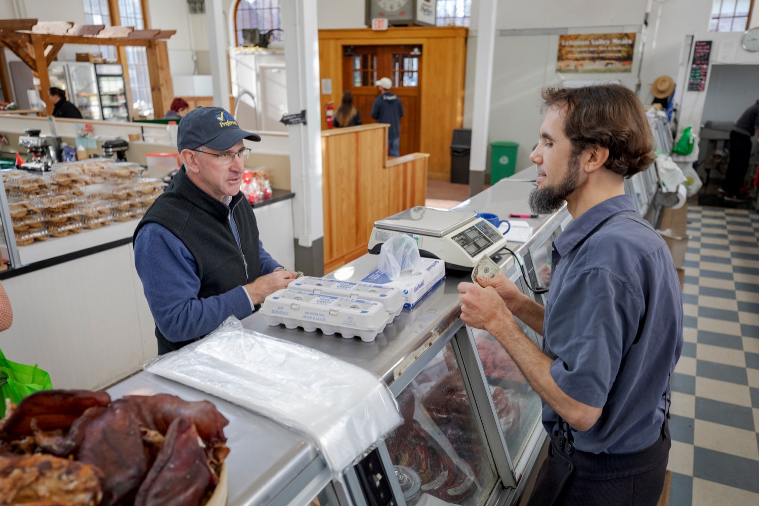 "<a href=""http://filesource.abacast.com/commonwealthofpa/photo/17546_AGRIC_Buy_Local_NK_023.JPG"" target=""_blank"">⇣ Download Photo<br></a>Steve Stoltzfus, owner of Lebanon Valley Meats, grabs two dozen eggs for Pennsylvania Department of Agriculture Secretary Russell Redding inside Broad Street Market on Thursday, November 21, 2019."