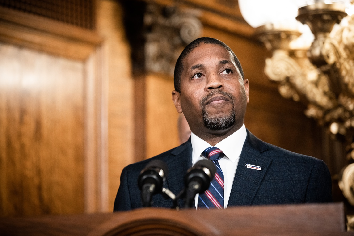 "<a href=""http://filesource.abacast.com/commonwealthofpa/photo/17554_gov_voter_reform_bill_dz_003.jpg"" target=""_blank"">⇣ Download Photo<br></a>Harrisburg, PA  Micah Sims, Executive Director, Common Cause PA speaks at the Election Reform Bill signing. Governor Wolf made voting more convenient and secure by signing Act 77 of 2019, the most significant improvement to Pennsylvanias elections in more than 80 years. The bipartisan compromise legislation takes effect for the April 2020 primary election and makes Pennsylvania a national leader with voter-friendly election reforms."