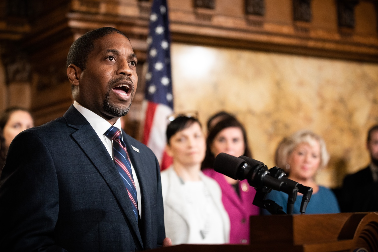 "<a href=""http://filesource.abacast.com/commonwealthofpa/photo/17554_gov_voter_reform_bill_dz_010.jpg"" target=""_blank"">⇣ Download Photo<br></a>Harrisburg, PA  Micah Sims, Executive Director, Common Cause PA speaks at the Election Reform Bill signing. Governor Wolf made voting more convenient and secure by signing Act 77 of 2019, the most significant improvement to Pennsylvanias elections in more than 80 years. The bipartisan compromise legislation takes effect for the April 2020 primary election and makes Pennsylvania a national leader with voter-friendly election reforms."