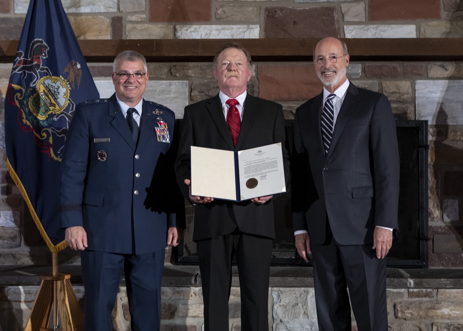"""<a href=""""http://filesource.abacast.com/commonwealthofpa/photo/17557_gov_dmva_rjw_014.jpg"""" target=""""_blank"""">⇣Download Photo<br></a>Governor Tom Wolf helped to honor two members inducted today into the Pennsylvania Department of Military and Veterans Affairs prestigious Hall of Fame, recognizing their exceptional service to the department that supports Pennsylvanias nearly 800,000 veterans and 18,000 members of the National Guard.  Chief Warrant Officer 5 (ret.) John K. Schreier of Selinsgrove, Snyder County; and John A. Brenner (posthumously) of Mt. Wolf, York County, are the 2019 inductees."""