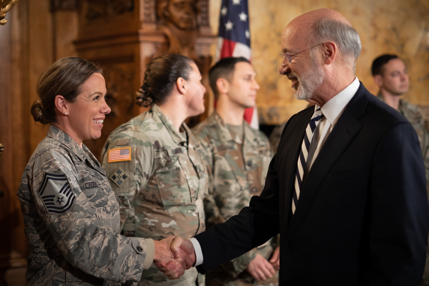 """<a href=""""http://filesource.abacast.com/commonwealthofpa/photo/17563_gov_giBill_dz_003.jpg"""" target=""""_blank"""">⇣Download Photo<br></a>Governor Tom Wolf greeting atendees. Governor Tom Wolf, joined by Pennsylvanias adjutant general and head of the Department of Military and Veterans Affairs Maj. Gen. Anthony Carelli, legislators and PA National Guard members and their families, encouraged PA National Guard members to take advantage of the new Military Family Education Program, or PA GI bill, now open for enrollment. Harrisburg, PA Monday, November 4 2019"""