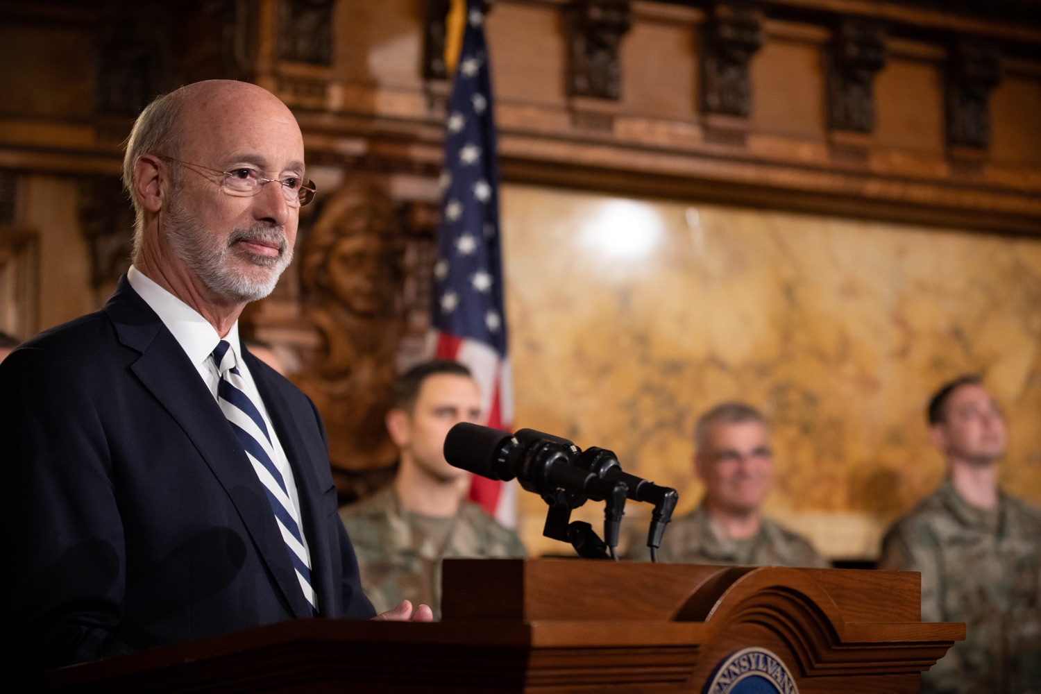 """<a href=""""http://filesource.abacast.com/commonwealthofpa/photo/17563_gov_giBill_dz_004.jpg"""" target=""""_blank"""">⇣Download Photo<br></a>Governor Tom Wolf speaking at the announcement. Governor Tom Wolf, joined by Pennsylvanias adjutant general and head of the Department of Military and Veterans Affairs Maj. Gen. Anthony Carelli, legislators and PA National Guard members and their families, encouraged PA National Guard members to take advantage of the new Military Family Education Program, or PA GI bill, now open for enrollment. Harrisburg, PA Monday, November 4 2019"""