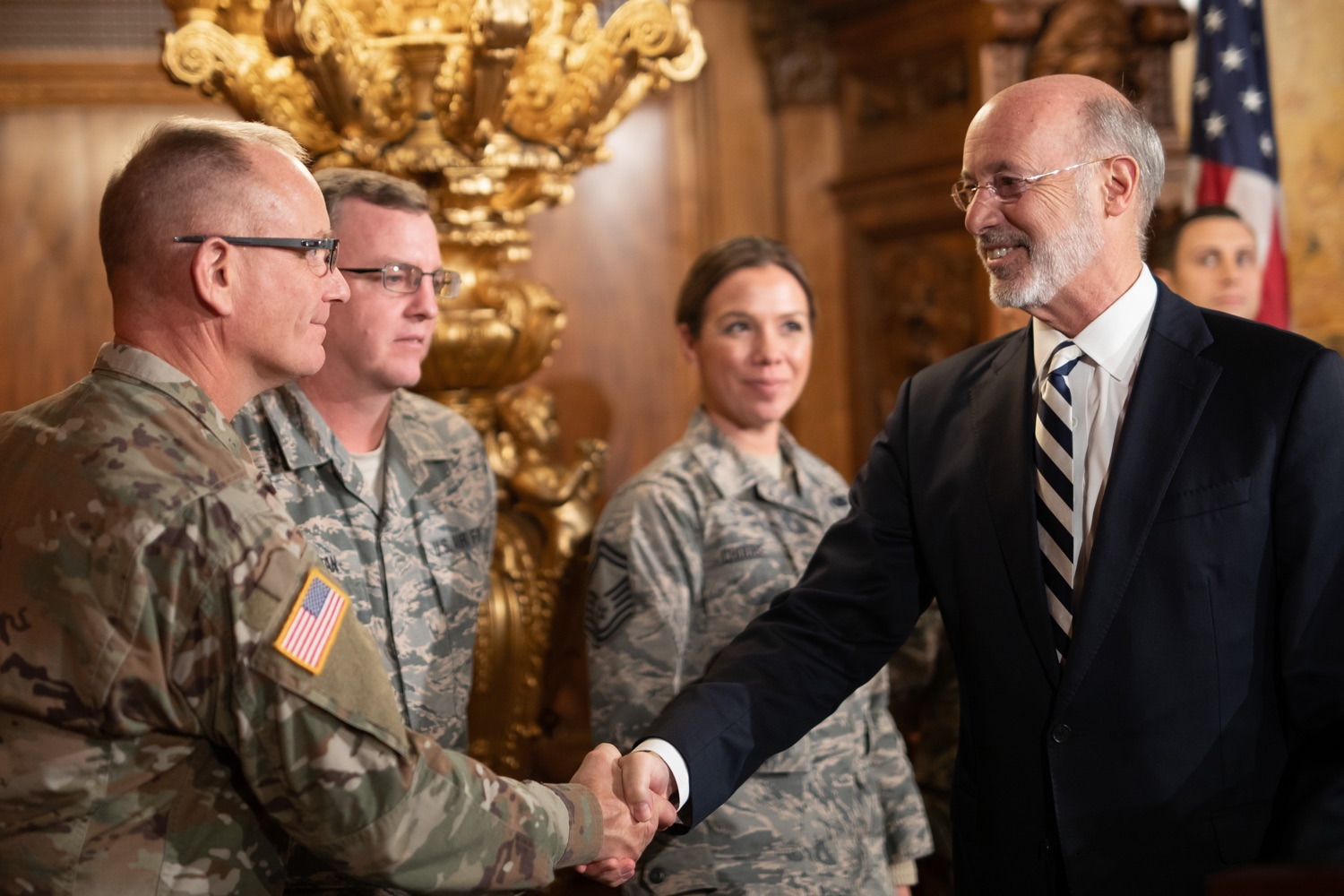 """<a href=""""http://filesource.abacast.com/commonwealthofpa/photo/17563_gov_giBill_dz_007.jpg"""" target=""""_blank"""">⇣Download Photo<br></a>Governor Tom Wolf greeting atendees. Governor Tom Wolf, joined by Pennsylvanias adjutant general and head of the Department of Military and Veterans Affairs Maj. Gen. Anthony Carelli, legislators and PA National Guard members and their families, encouraged PA National Guard members to take advantage of the new Military Family Education Program, or PA GI bill, now open for enrollment. Harrisburg, PA Monday, November 4 2019"""