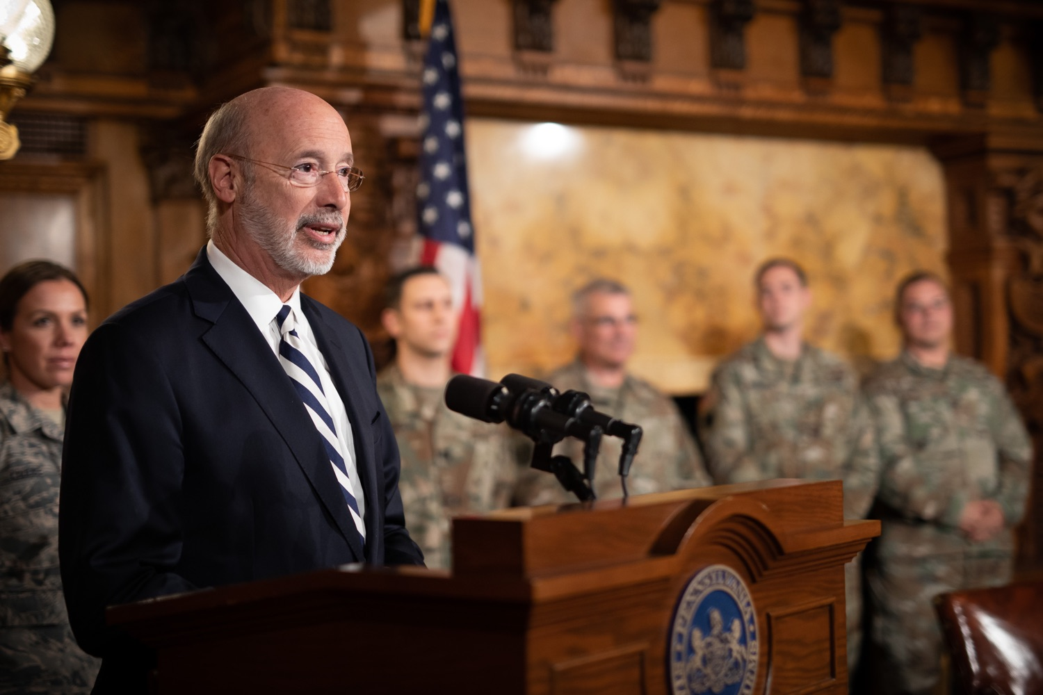 """<a href=""""http://filesource.abacast.com/commonwealthofpa/photo/17563_gov_giBill_dz_008.jpg"""" target=""""_blank"""">⇣Download Photo<br></a>Governor Tom Wolf speaking at the announcement. Governor Tom Wolf, joined by Pennsylvanias adjutant general and head of the Department of Military and Veterans Affairs Maj. Gen. Anthony Carelli, legislators and PA National Guard members and their families, encouraged PA National Guard members to take advantage of the new Military Family Education Program, or PA GI bill, now open for enrollment. Harrisburg, PA Monday, November 4 2019"""