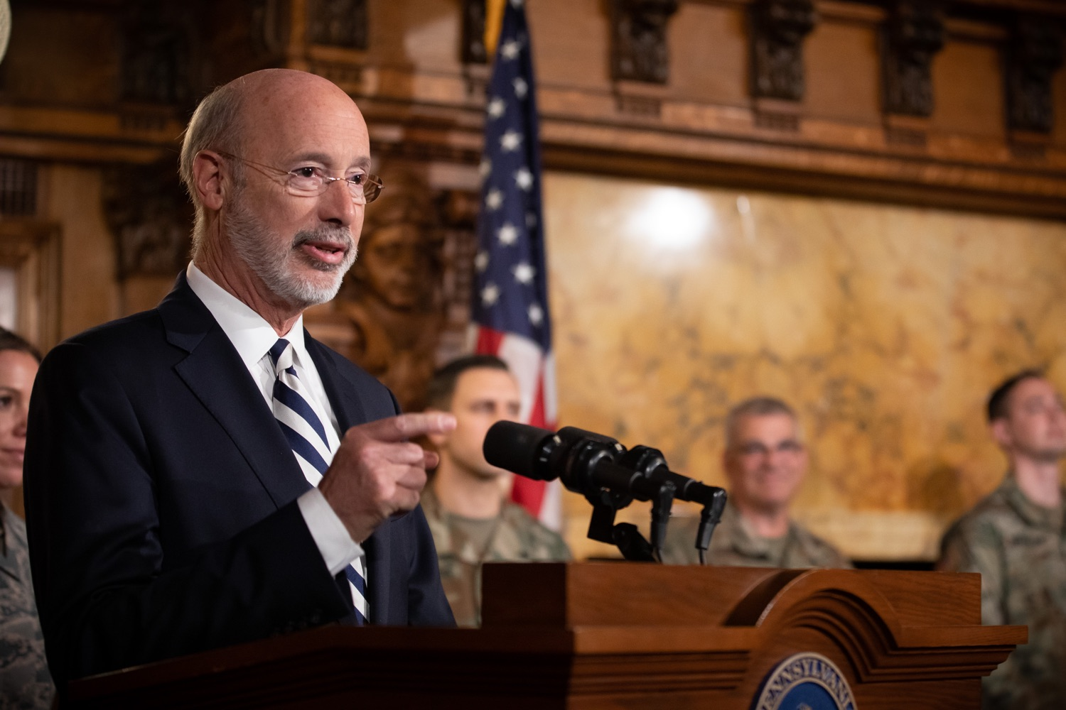 """<a href=""""http://filesource.abacast.com/commonwealthofpa/photo/17563_gov_giBill_dz_014.jpg"""" target=""""_blank"""">⇣Download Photo<br></a>Governor Tom Wolf speaking at the announcement. Governor Tom Wolf, joined by Pennsylvanias adjutant general and head of the Department of Military and Veterans Affairs Maj. Gen. Anthony Carelli, legislators and PA National Guard members and their families, encouraged PA National Guard members to take advantage of the new Military Family Education Program, or PA GI bill, now open for enrollment. Harrisburg, PA Monday, November 4 2019"""