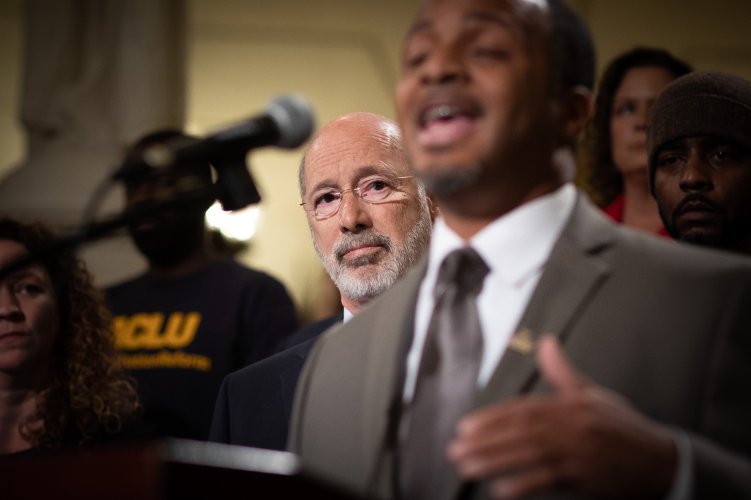 """<a href=""""http://filesource.abacast.com/commonwealthofpa/photo/17601_gov_right_on_crime_dz_018.jpg"""" target=""""_blank"""">⇣Download Photo<br></a>Governor Tom Wolf listening to Deputy Secretary of Corrections Christian Stephens speaking at the event.  at the event. Governor Tom Wolf was joined by Deputy Secretary of Corrections Christian Stephens and national criminal justice reform advocates today in the Capitol Rotunda to push for commonsense probation reforms that address probation sentences and probation lengths.  Harrisburg, PA  November 18, 2019"""