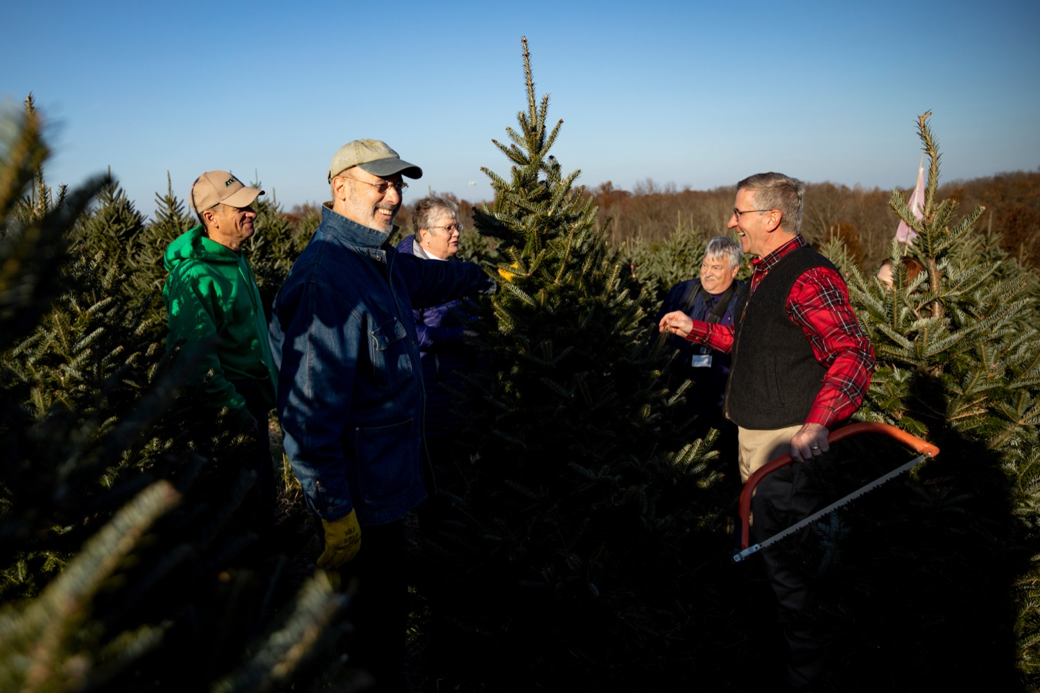 "<a href=""http://filesource.abacast.com/commonwealthofpa/photo/17615_GOV_AGRIC_Christmas_Trees_NK_001.JPG"" target=""_blank"">⇣ Download Photo<br></a>Pennsylvania Governor Tom Wolf, front left, and Pennsylvania Agriculture Secretary Russell Redding, front right, smile before cutting down a Christmas tree on Monday, November 25, 2019."
