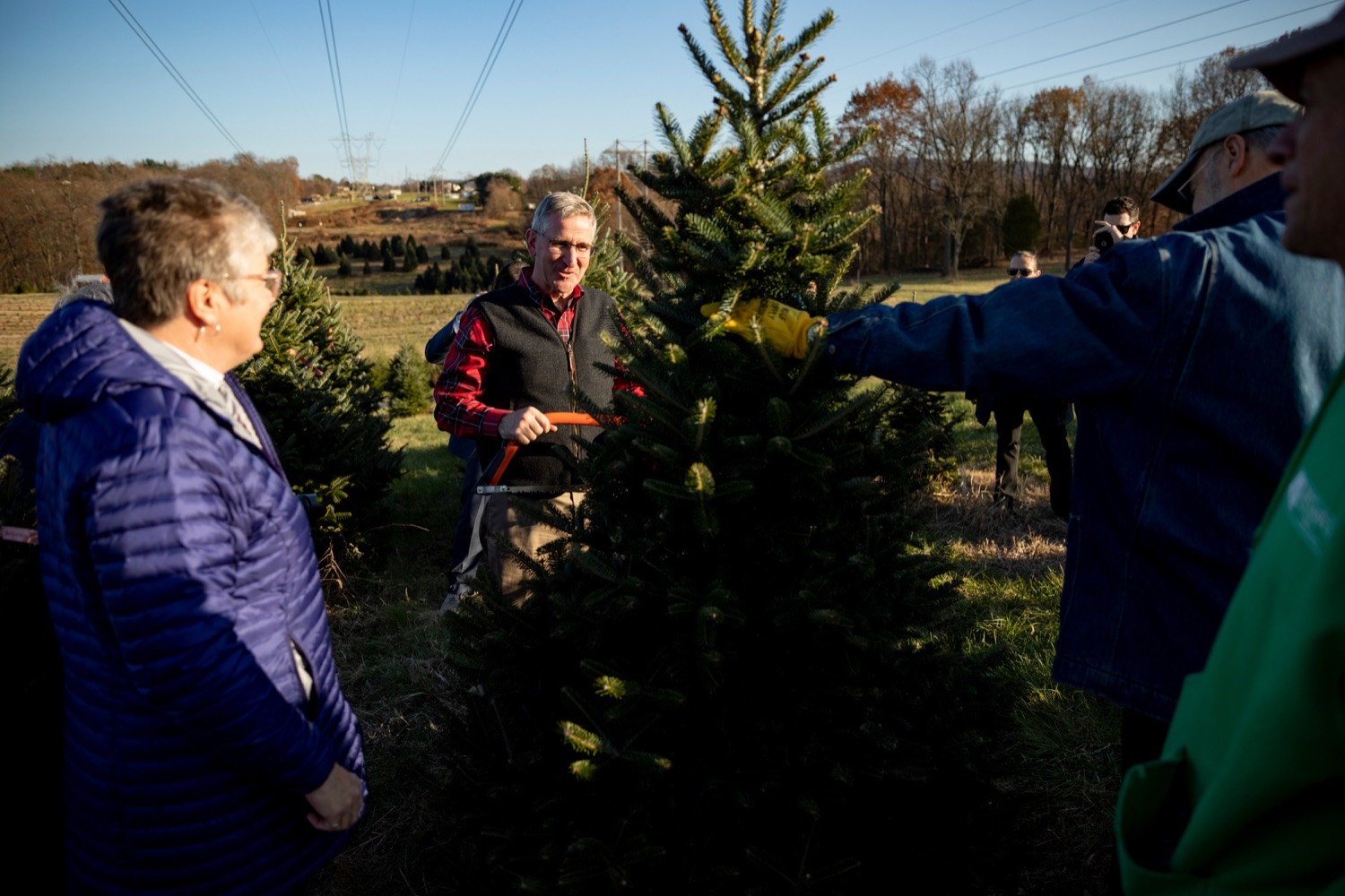 "<a href=""http://filesource.abacast.com/commonwealthofpa/photo/17615_GOV_AGRIC_Christmas_Trees_NK_010.JPG"" target=""_blank"">⇣ Download Photo<br></a>Pennsylvania Agriculture Secretary Russell Redding smiles with his wife, Nina, left, before cutting down a Christmas tree on Monday, November 25, 2019."