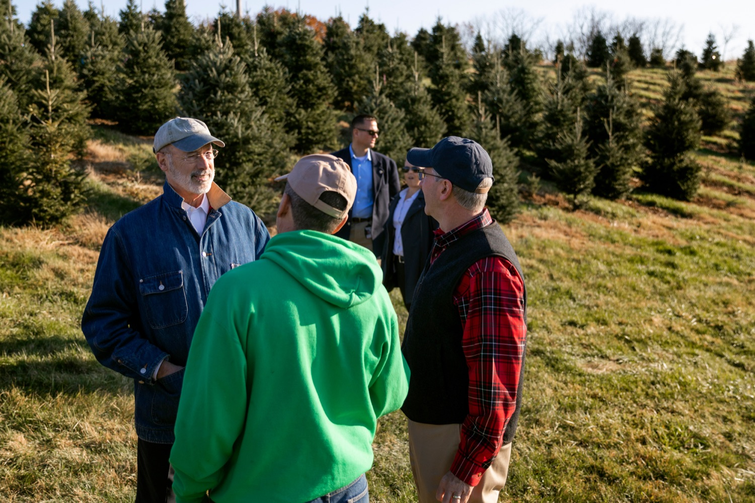 "<a href=""http://filesource.abacast.com/commonwealthofpa/photo/17615_GOV_AGRIC_Christmas_Trees_NK_012.JPG"" target=""_blank"">⇣ Download Photo<br></a>Pennsylvania Governor Tom Wolf, left, Pennsylvania Agriculture Secretary Russell Redding, right and Mark McCurdy, owner of McCurdy's Tree Farm & Landscaping, talk together on Monday, November 25, 2019."