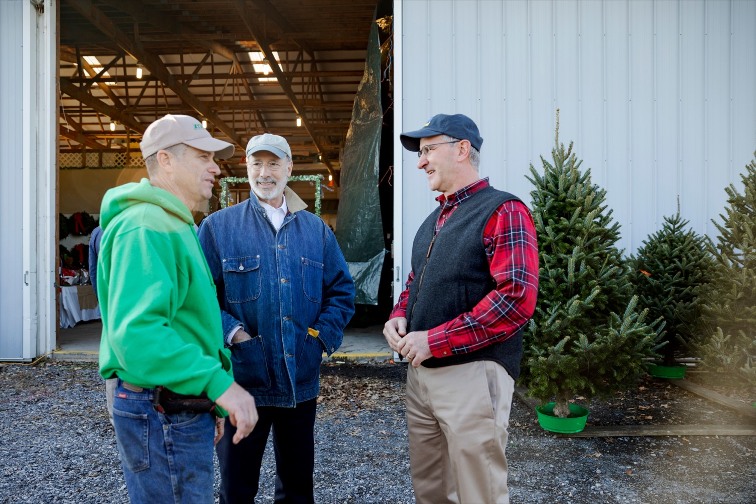 "<a href=""http://filesource.abacast.com/commonwealthofpa/photo/17615_GOV_AGRIC_Christmas_Trees_NK_015.JPG"" target=""_blank"">⇣ Download Photo<br></a>Pennsylvania Governor Tom Wolf, center, Pennsylvania Agriculture Secretary Russell Redding, right and Mark McCurdy, owner of McCurdy's Tree Farm & Landscaping, talk together on Monday, November 25, 2019."