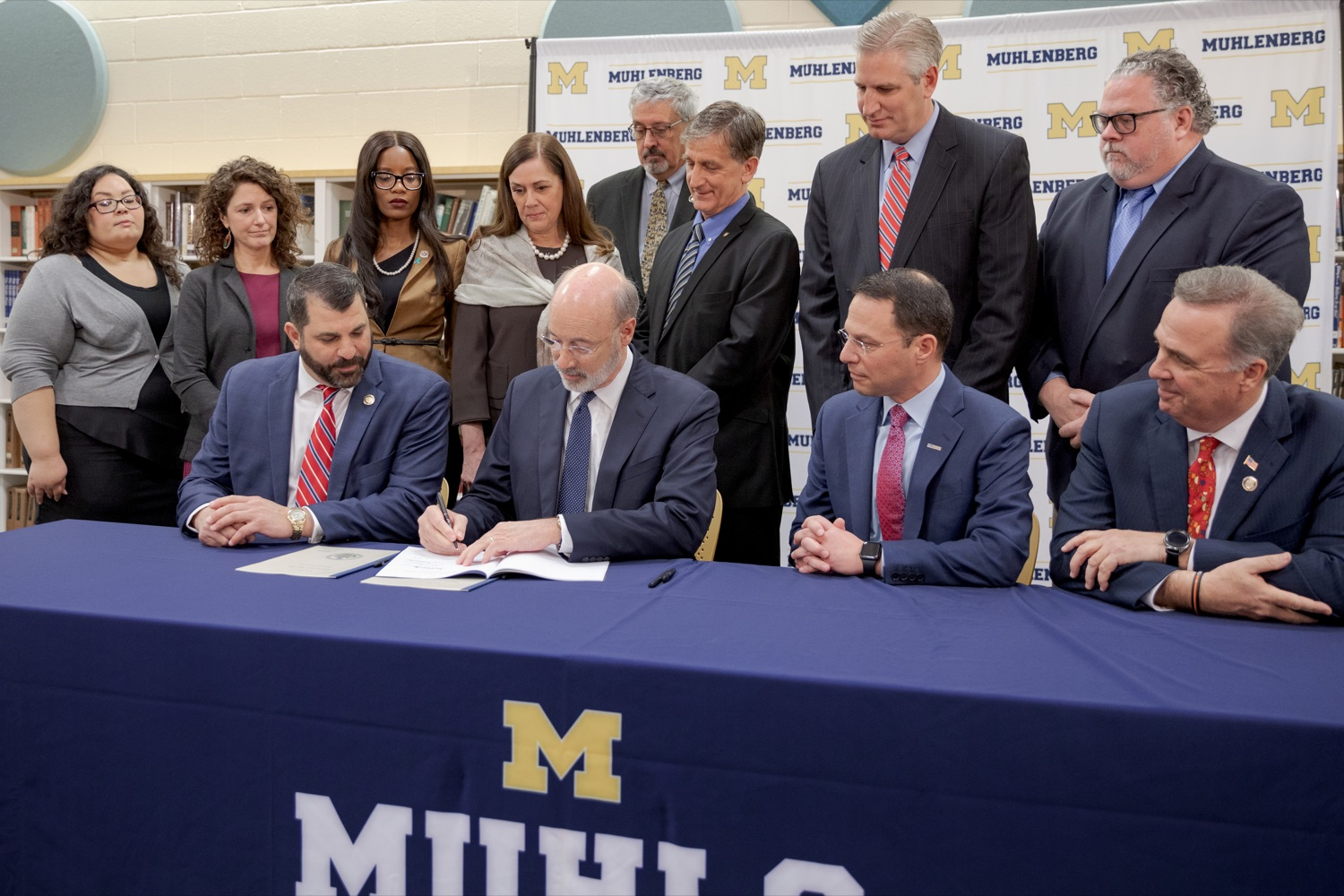 """<a href=""""http://filesource.abacast.com/commonwealthofpa/photo/17628_GOV_AG_Bill_Signing_NK_006.JPG"""" target=""""_blank"""">⇣Download Photo<br></a>From left; State Rep. Mark Rozzi, Governor Tom Wolf, Attorney General Josh Shapiro, and State Rep. Jim Gregory sign a package of three bills, which mirror three of the Grand Jurys recommendations on addressing the statute of limitations for victims of child sexual abuse, inside Muhlenberg High School on Tuesday, November 26, 2019."""