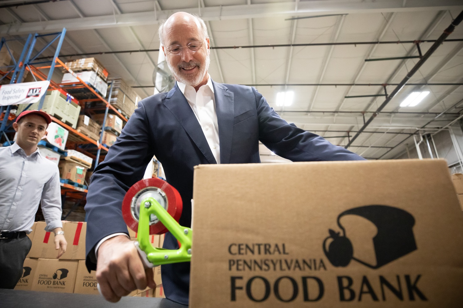 "<a href=""http://filesource.abacast.com/commonwealthofpa/photo/17632_gov_foodbank_volunteering_dz_001.jpg"" target=""_blank"">⇣ Download Photo<br></a>Governor Tom Wolf loading boxes of food at the Central Pennsylvania Food Bank.  The governor and first lady visit the Central Pennsylvania Food Bank in Harrisburg to participate in a volunteer project, packing boxes of food for veterans and their families. Ahead of Thanksgiving and the holiday season, Governor Tom Wolf and First Lady Frances Wolf are reminding Pennsylvanians of the importance of helping each other. Harrisburg, PA  Tuesday November 26, 2019"