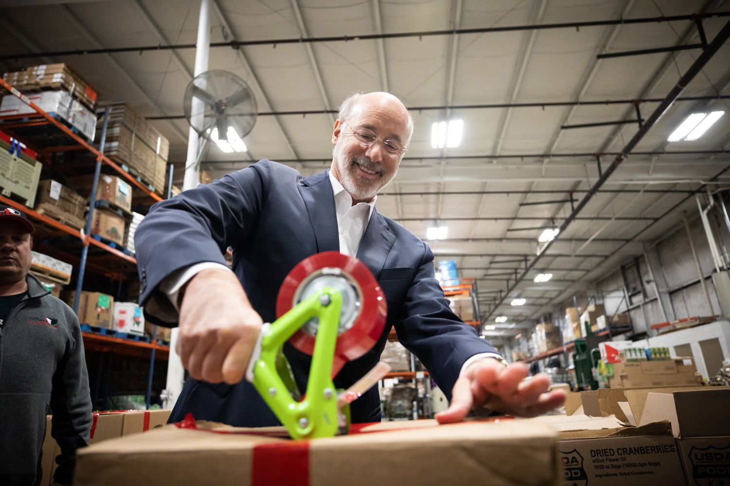 "<a href=""http://filesource.abacast.com/commonwealthofpa/photo/17632_gov_foodbank_volunteering_dz_002.jpg"" target=""_blank"">⇣ Download Photo<br></a>Governor Tom Wolf loading boxes of food at the Central Pennsylvania Food Bank.  The governor and first lady visit the Central Pennsylvania Food Bank in Harrisburg to participate in a volunteer project, packing boxes of food for veterans and their families. Ahead of Thanksgiving and the holiday season, Governor Tom Wolf and First Lady Frances Wolf are reminding Pennsylvanians of the importance of helping each other. Harrisburg, PA  Tuesday November 26, 2019"