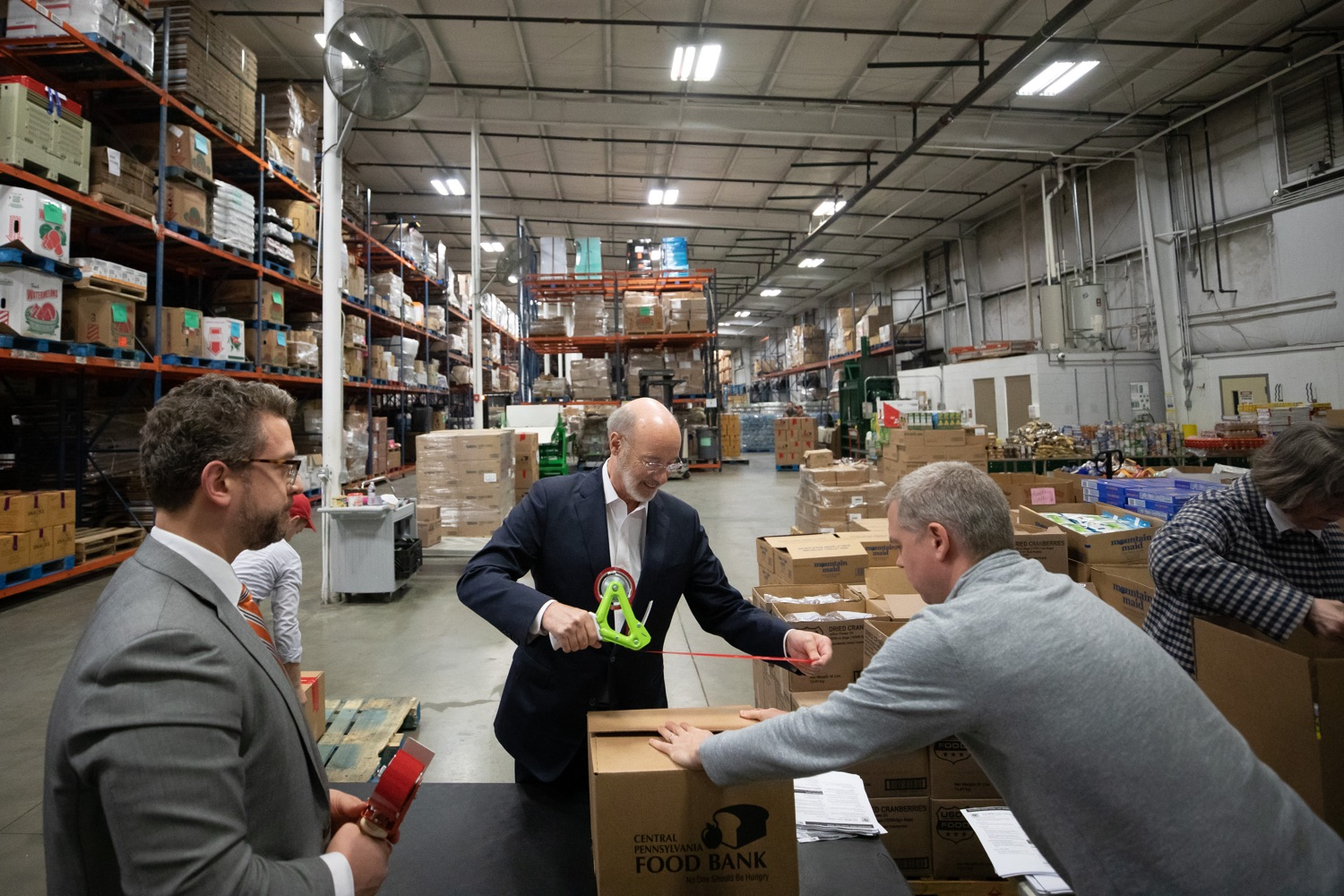 "<a href=""http://filesource.abacast.com/commonwealthofpa/photo/17632_gov_foodbank_volunteering_dz_003.jpg"" target=""_blank"">⇣ Download Photo<br></a>Governor Tom Wolf loading boxes of food at the Central Pennsylvania Food Bank.  The governor and first lady visit the Central Pennsylvania Food Bank in Harrisburg to participate in a volunteer project, packing boxes of food for veterans and their families. Ahead of Thanksgiving and the holiday season, Governor Tom Wolf and First Lady Frances Wolf are reminding Pennsylvanians of the importance of helping each other. Harrisburg, PA  Tuesday November 26, 2019"