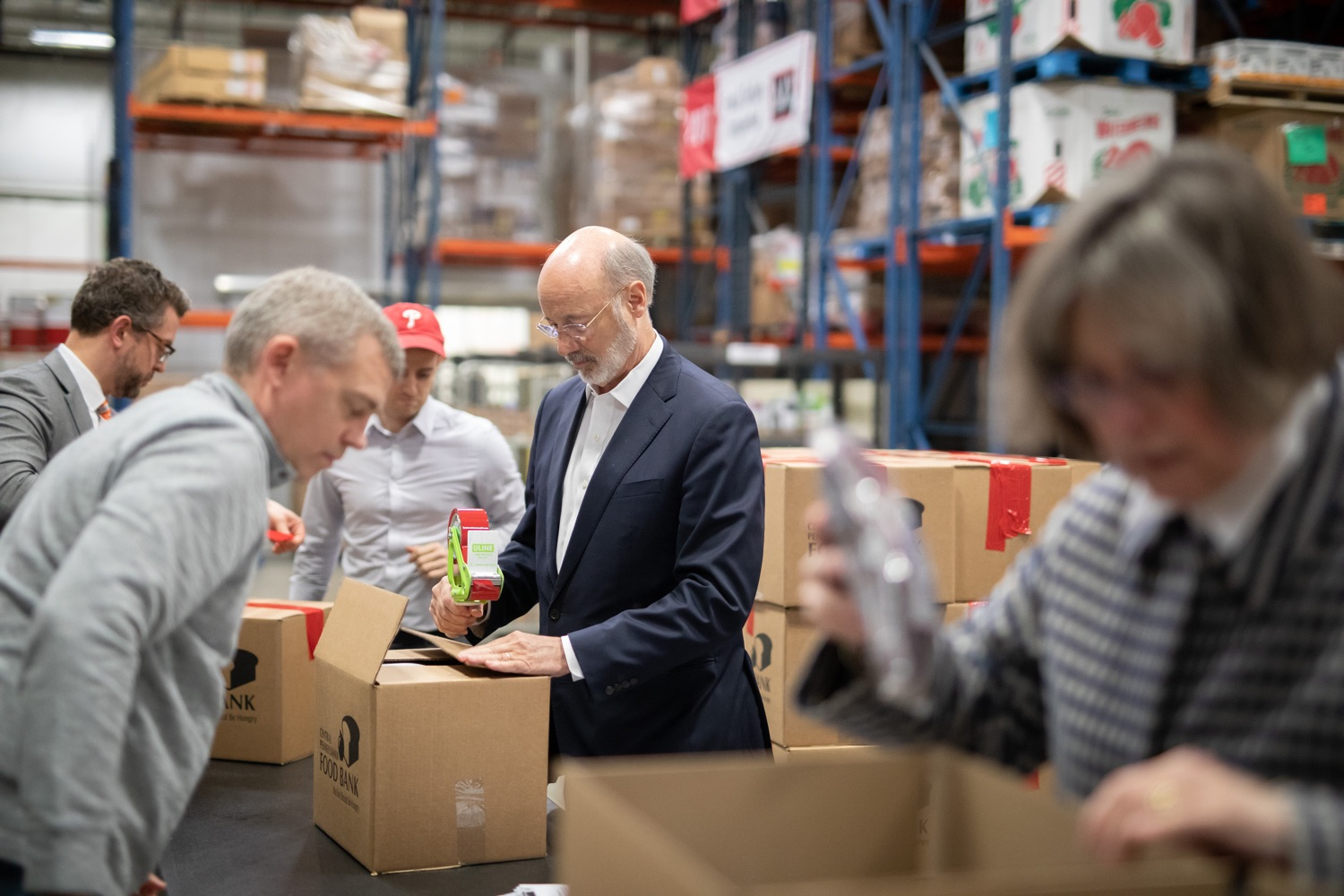 "<a href=""http://filesource.abacast.com/commonwealthofpa/photo/17632_gov_foodbank_volunteering_dz_007.jpg"" target=""_blank"">⇣ Download Photo<br></a>Governor Tom Wolf loading boxes of food at the Central Pennsylvania Food Bank.  The governor and first lady visit the Central Pennsylvania Food Bank in Harrisburg to participate in a volunteer project, packing boxes of food for veterans and their families. Ahead of Thanksgiving and the holiday season, Governor Tom Wolf and First Lady Frances Wolf are reminding Pennsylvanians of the importance of helping each other. Harrisburg, PA  Tuesday November 26, 2019"