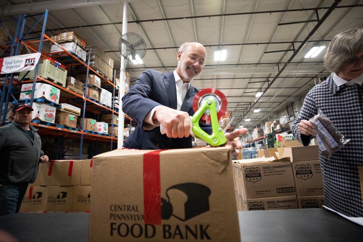 "<a href=""http://filesource.abacast.com/commonwealthofpa/photo/17632_gov_foodbank_volunteering_dz_013.jpg"" target=""_blank"">⇣ Download Photo<br></a>Governor Tom Wolf loading boxes of food at the Central Pennsylvania Food Bank.  The governor and first lady visit the Central Pennsylvania Food Bank in Harrisburg to participate in a volunteer project, packing boxes of food for veterans and their families. Ahead of Thanksgiving and the holiday season, Governor Tom Wolf and First Lady Frances Wolf are reminding Pennsylvanians of the importance of helping each other. Harrisburg, PA  Tuesday November 26, 2019"