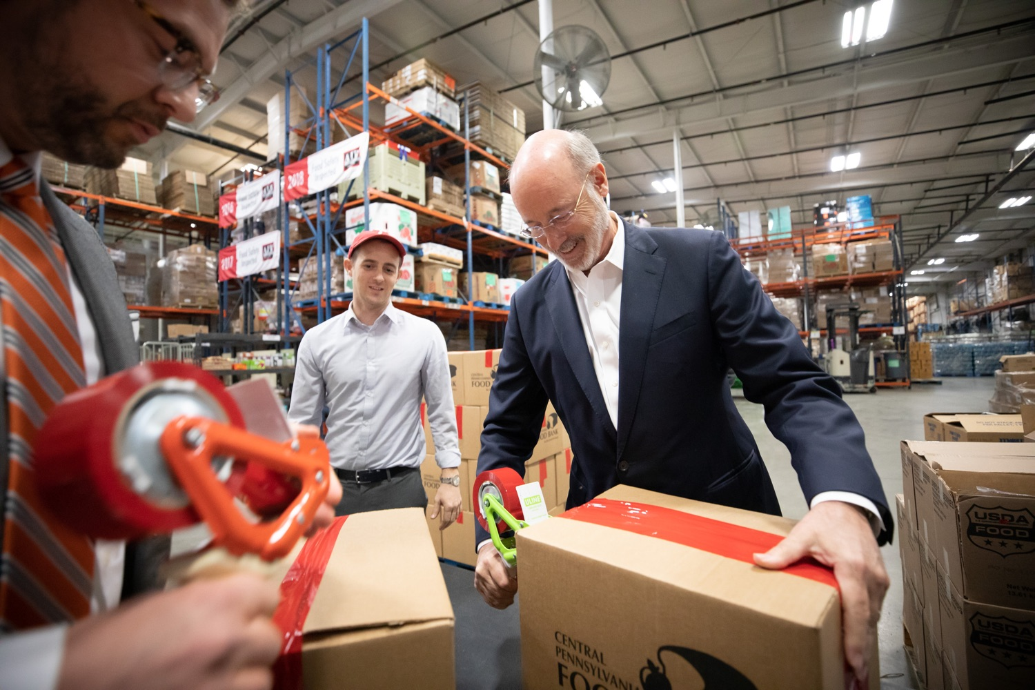 "<a href=""http://filesource.abacast.com/commonwealthofpa/photo/17632_gov_foodbank_volunteering_dz_015.jpg"" target=""_blank"">⇣ Download Photo<br></a>Governor Tom Wolf loading boxes of food at the Central Pennsylvania Food Bank.  The governor and first lady visit the Central Pennsylvania Food Bank in Harrisburg to participate in a volunteer project, packing boxes of food for veterans and their families. Ahead of Thanksgiving and the holiday season, Governor Tom Wolf and First Lady Frances Wolf are reminding Pennsylvanians of the importance of helping each other. Harrisburg, PA  Tuesday November 26, 2019"