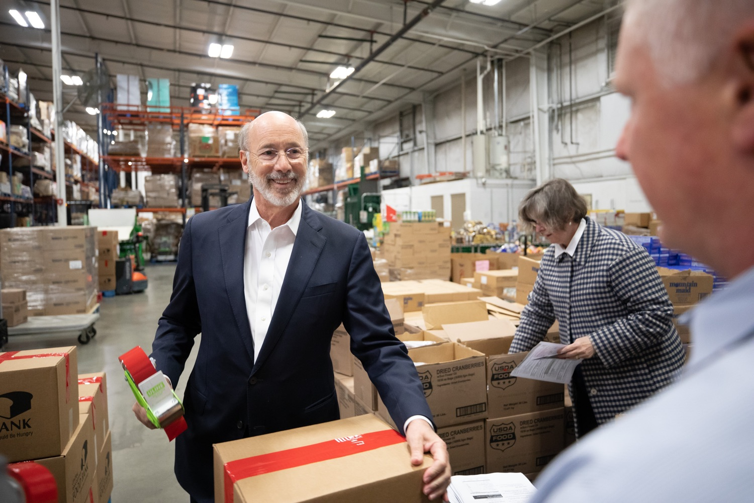"<a href=""http://filesource.abacast.com/commonwealthofpa/photo/17632_gov_foodbank_volunteering_dz_016.jpg"" target=""_blank"">⇣ Download Photo<br></a>Governor Tom Wolf loading boxes of food at the Central Pennsylvania Food Bank.  The governor and first lady visit the Central Pennsylvania Food Bank in Harrisburg to participate in a volunteer project, packing boxes of food for veterans and their families. Ahead of Thanksgiving and the holiday season, Governor Tom Wolf and First Lady Frances Wolf are reminding Pennsylvanians of the importance of helping each other. Harrisburg, PA  Tuesday November 26, 2019"