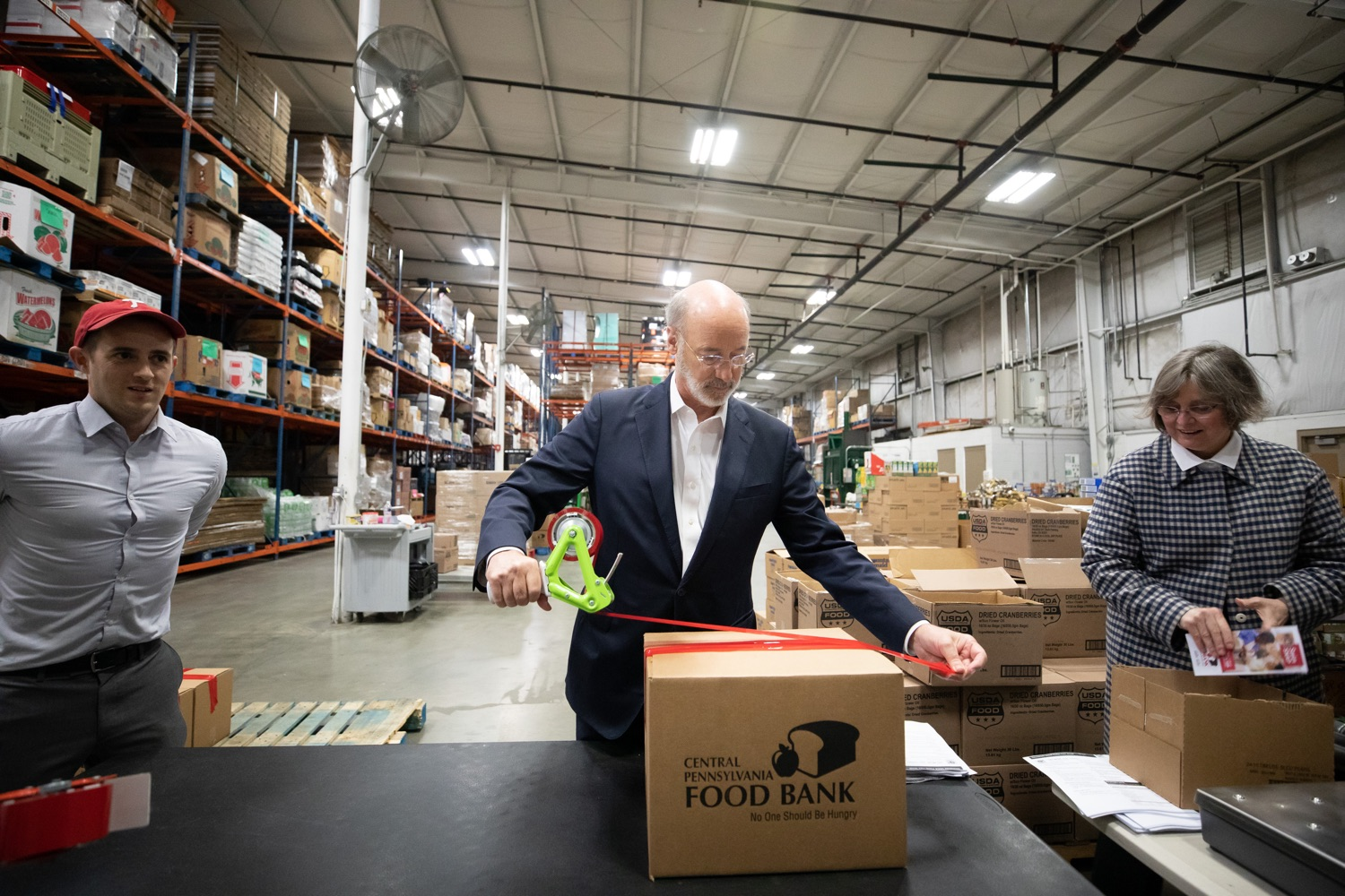 "<a href=""http://filesource.abacast.com/commonwealthofpa/photo/17632_gov_foodbank_volunteering_dz_017.jpg"" target=""_blank"">⇣ Download Photo<br></a>Governor Tom Wolf loading boxes of food at the Central Pennsylvania Food Bank.  The governor and first lady visit the Central Pennsylvania Food Bank in Harrisburg to participate in a volunteer project, packing boxes of food for veterans and their families. Ahead of Thanksgiving and the holiday season, Governor Tom Wolf and First Lady Frances Wolf are reminding Pennsylvanians of the importance of helping each other. Harrisburg, PA  Tuesday November 26, 2019"
