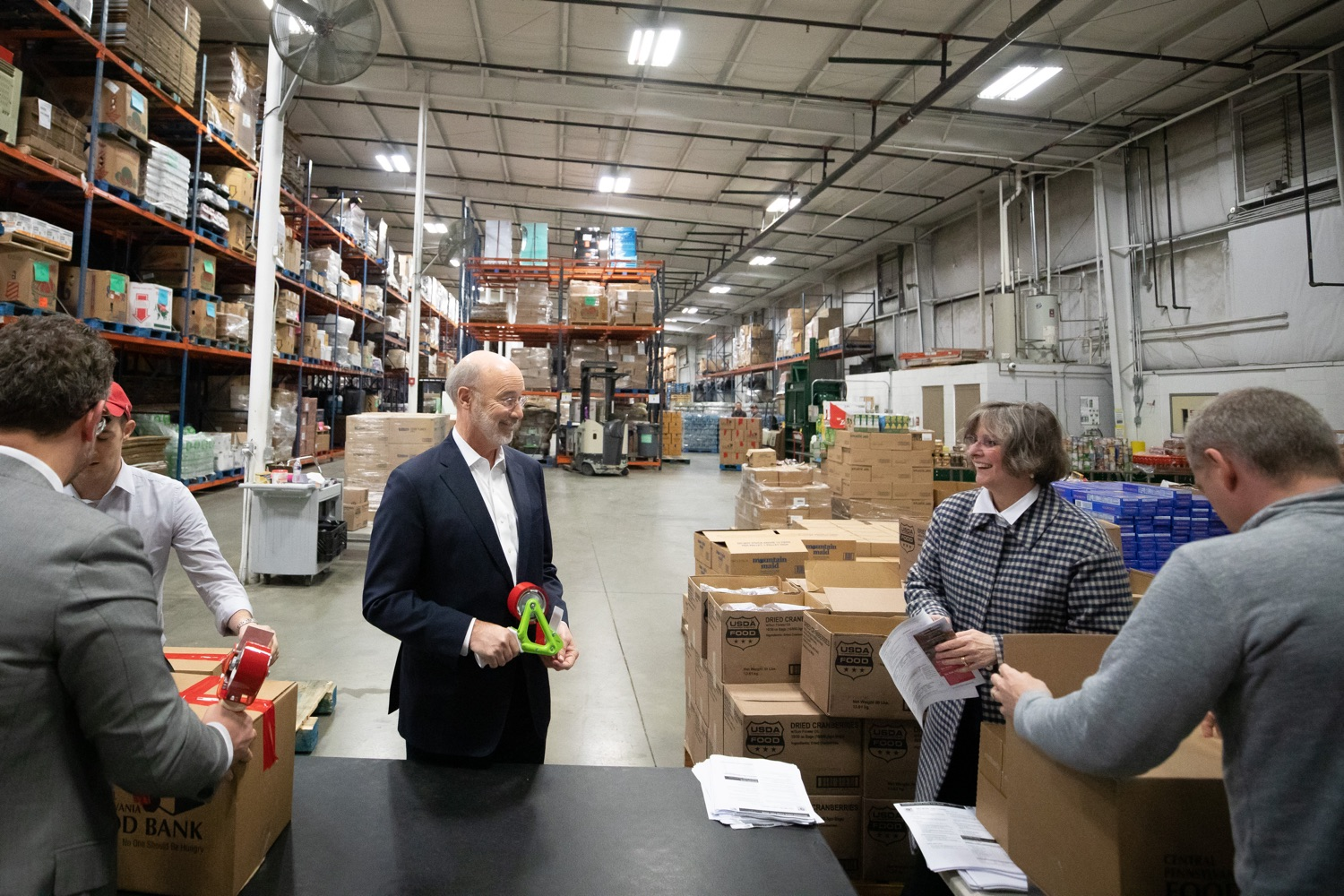 "<a href=""http://filesource.abacast.com/commonwealthofpa/photo/17632_gov_foodbank_volunteering_dz_018.jpg"" target=""_blank"">⇣ Download Photo<br></a>Governor Tom Wolf loading boxes of food at the Central Pennsylvania Food Bank.  The governor and first lady visit the Central Pennsylvania Food Bank in Harrisburg to participate in a volunteer project, packing boxes of food for veterans and their families. Ahead of Thanksgiving and the holiday season, Governor Tom Wolf and First Lady Frances Wolf are reminding Pennsylvanians of the importance of helping each other. Harrisburg, PA  Tuesday November 26, 2019"