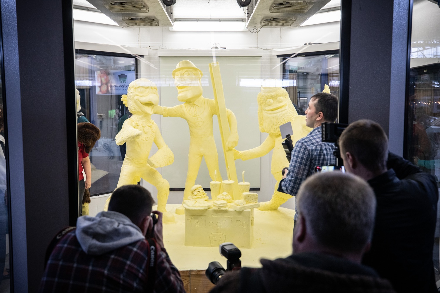 "<a href=""http://filesource.abacast.com/commonwealthofpa/photo/17646_agric_butter_sculpture_dz_006.jpg"" target=""_blank"">⇣ Download Photo<br></a>Press crowdind around the butter sculpture for the big reveal. Lt. Governor John Fetterman and Secretary of Agriculture Russell Redding today unveiled the 2020 Pennsylvania Farm Show butter sculpture, carved from a half-ton of butter depicting three of Pennsylvanias beloved professional sports mascots: Philadelphia Flyers Gritty, Philadelphia Eagles Swoop, and Pittsburgh Steelers Steely McBeam celebrating with a spread of Pennsylvania dairy products. The sculpture, a long-time Farm Show staple, encourages Pennsylvanians to be a fan of Pennsylvania dairy and give a cheer to the more than 6,200 dairy farmers in the commonwealth.  Harrisburg, PA  January 2, 2020"
