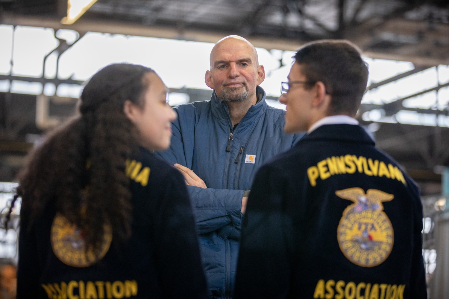 "<a href=""http://filesource.abacast.com/commonwealthofpa/photo/17646_agric_butter_sculpture_dz_013.jpg"" target=""_blank"">⇣ Download Photo<br></a>Lt. Governor John Fetterman speaking to Pennsylvania FFA members.  Lt. Governor John Fetterman and Secretary of Agriculture Russell Redding today unveiled the 2020 Pennsylvania Farm Show butter sculpture, carved from a half-ton of butter depicting three of Pennsylvanias beloved professional sports mascots: Philadelphia Flyers Gritty, Philadelphia Eagles Swoop, and Pittsburgh Steelers Steely McBeam celebrating with a spread of Pennsylvania dairy products. The sculpture, a long-time Farm Show staple, encourages Pennsylvanians to be a fan of Pennsylvania dairy and give a cheer to the more than 6,200 dairy farmers in the commonwealth.  Harrisburg, PA  January 2, 2020"