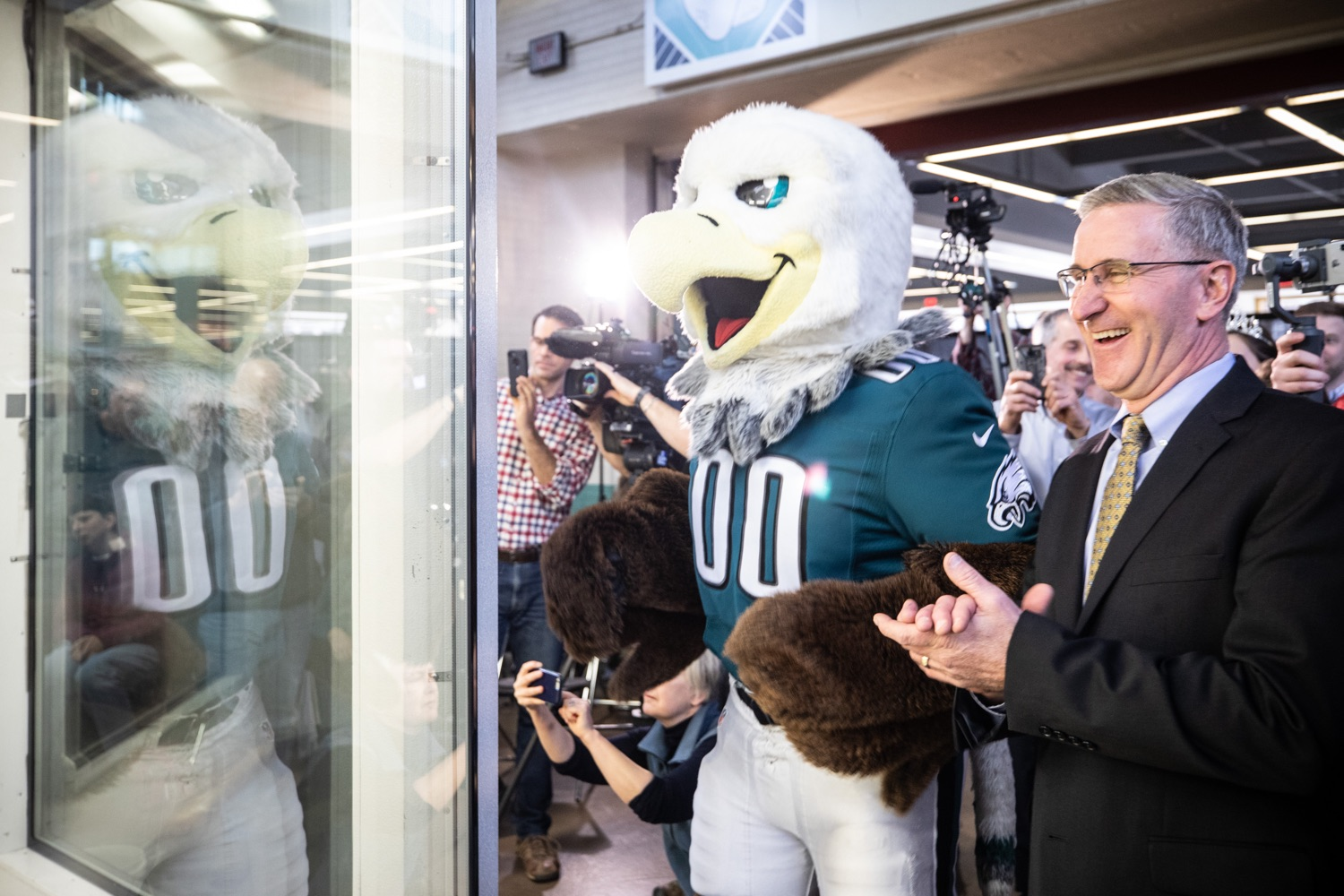 "<a href=""http://filesource.abacast.com/commonwealthofpa/photo/17646_agric_butter_sculpture_dz_019.jpg"" target=""_blank"">⇣ Download Photo<br></a>Philadelphia Eagles Swoop, and Secretary of Agriculture Russell Redding check out the Pennsylvania Farm Show butter sculpture.  Lt. Governor John Fetterman and Secretary of Agriculture Russell Redding today unveiled the 2020 Pennsylvania Farm Show butter sculpture, carved from a half-ton of butter depicting three of Pennsylvanias beloved professional sports mascots: Philadelphia Flyers Gritty, Philadelphia Eagles Swoop, and Pittsburgh Steelers Steely McBeam celebrating with a spread of Pennsylvania dairy products. The sculpture, a long-time Farm Show staple, encourages Pennsylvanians to be a fan of Pennsylvania dairy and give a cheer to the more than 6,200 dairy farmers in the commonwealth.  Harrisburg, PA  January 2, 2020"