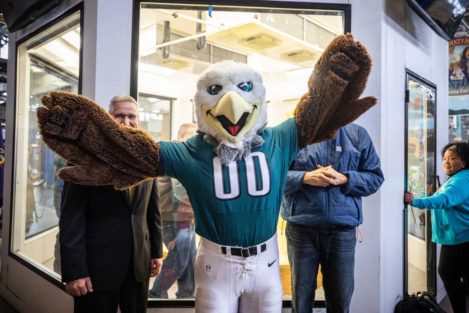 "<a href=""http://filesource.abacast.com/commonwealthofpa/photo/17646_agric_butter_sculpture_dz_021.jpg"" target=""_blank"">⇣ Download Photo<br></a>Philadelphia Eagles Swoop, Lt. Governor John Fetterman,  and Secretary of Agriculture Russell Redding at the Pennsylvania Farm Show butter sculpture.  Lt. Governor John Fetterman and Secretary of Agriculture Russell Redding today unveiled the 2020 Pennsylvania Farm Show butter sculpture, carved from a half-ton of butter depicting three of Pennsylvanias beloved professional sports mascots: Philadelphia Flyers Gritty, Philadelphia Eagles Swoop, and Pittsburgh Steelers Steely McBeam celebrating with a spread of Pennsylvania dairy products. The sculpture, a long-time Farm Show staple, encourages Pennsylvanians to be a fan of Pennsylvania dairy and give a cheer to the more than 6,200 dairy farmers in the commonwealth.  Harrisburg, PA  January 2, 2020"