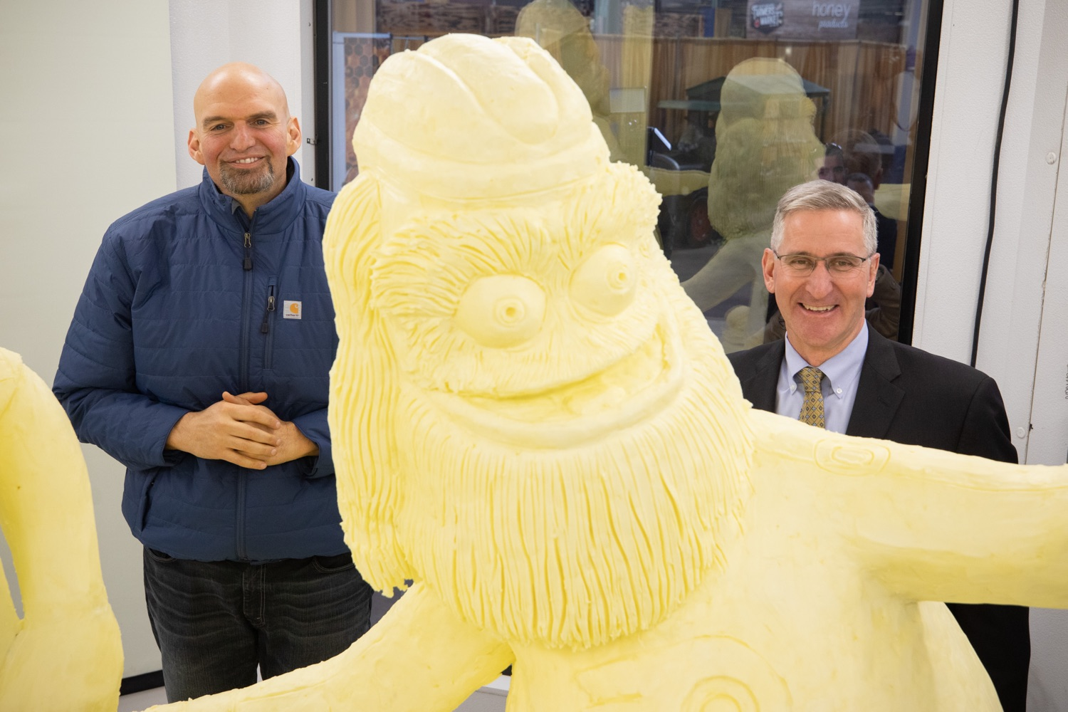 "<a href=""http://filesource.abacast.com/commonwealthofpa/photo/17646_agric_butter_sculpture_dz_023.jpg"" target=""_blank"">⇣ Download Photo<br></a>Lt. Governor John Fetterman,  and Secretary of Agriculture Russell Redding at the Pennsylvania Farm Show butter sculpture.  Lt. Governor John Fetterman and Secretary of Agriculture Russell Redding today unveiled the 2020 Pennsylvania Farm Show butter sculpture, carved from a half-ton of butter depicting three of Pennsylvanias beloved professional sports mascots: Philadelphia Flyers Gritty, Philadelphia Eagles Swoop, and Pittsburgh Steelers Steely McBeam celebrating with a spread of Pennsylvania dairy products. The sculpture, a long-time Farm Show staple, encourages Pennsylvanians to be a fan of Pennsylvania dairy and give a cheer to the more than 6,200 dairy farmers in the commonwealth.  Harrisburg, PA  January 2, 2020"