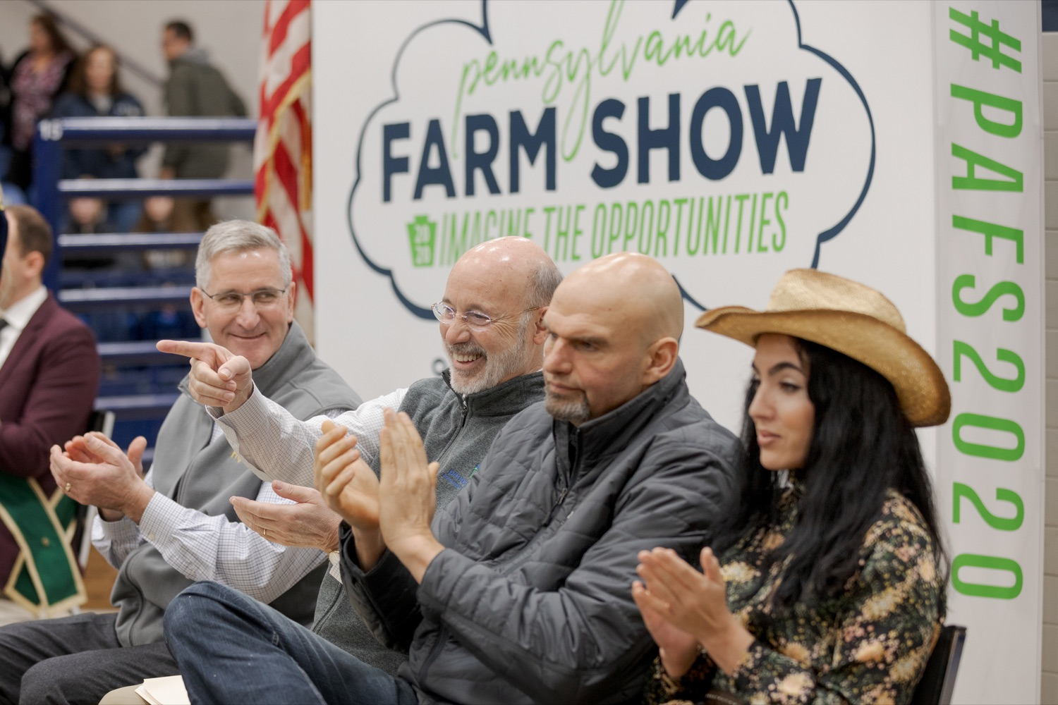 """<a href=""""http://filesource.abacast.com/commonwealthofpa/photo/17648_AGRIC_Opening_Ceremonies_NK_001.JPG"""" target=""""_blank"""">⇣Download Photo<br></a>From left; Pennsylvania Department of Agriculture Secretary Russell Redding; Pennsylvania Governor Tom Wolf; Pennsylvania Lt. Governor John Fetterman; and Gisele Fetterman, Pennsylvania's second lady, sit together during the kick-off of the 2020 Pennsylvania Farm Show on Saturday, January 4, 2020."""