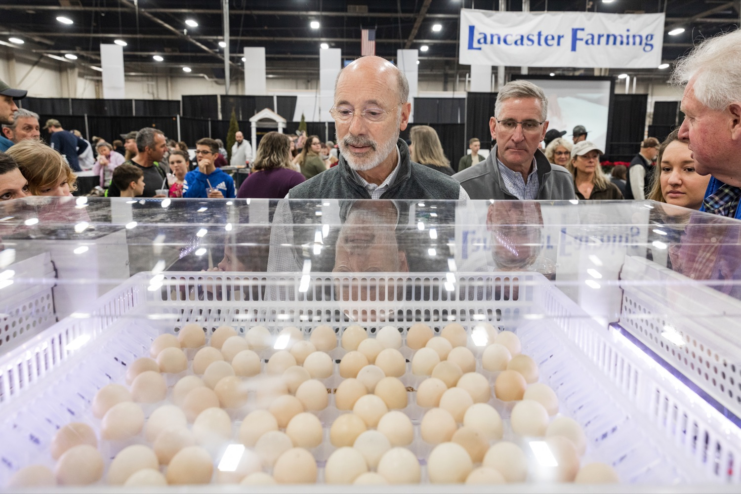 """<a href=""""http://filesource.abacast.com/commonwealthofpa/photo/17648_AGRIC_Opening_Ceremonies_NK_007.JPG"""" target=""""_blank"""">⇣Download Photo<br></a>Pennsylvania Governor Tom Wolf and Pennsylvania Secretary of Agriculture Russell Redding look at chicken eggs during the kick-off of the 2020 Pennsylvania Farm Show on Saturday, January 4, 2020."""