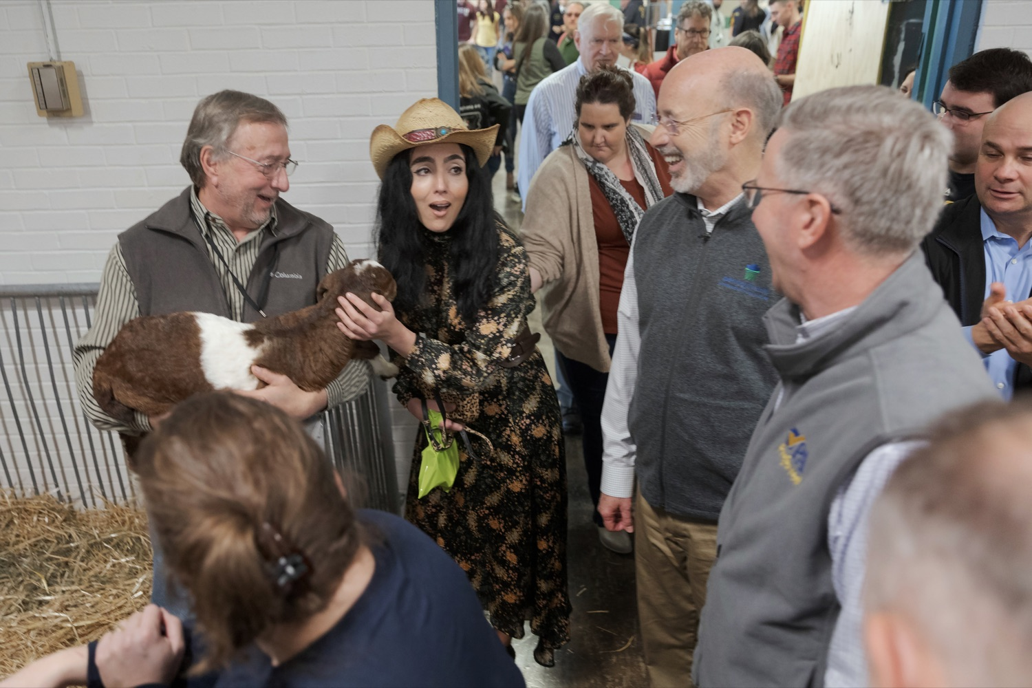 """<a href=""""http://filesource.abacast.com/commonwealthofpa/photo/17648_AGRIC_Opening_Ceremonies_NK_010.JPG"""" target=""""_blank"""">⇣Download Photo<br></a>Gisele Fetterman, Pennsylvania's second lady, center left, reacts to a baby goat with Pennsylvania Governor Tom Wolf during the kick-off of the 2020 Pennsylvania Farm Show on Saturday, January 4, 2020."""