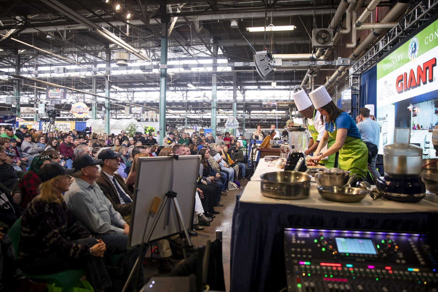 """<a href=""""http://filesource.abacast.com/commonwealthofpa/photo/17651_AGRIC_ARMY_NAVY_COOKOFF_CZ_04.jpg"""" target=""""_blank"""">⇣Download Photo<br></a>Audiences packed the Culinary Connection stage to watch the 2020 Army vs. Navy Cook-Off in Harrisburg on January 9, 2020."""