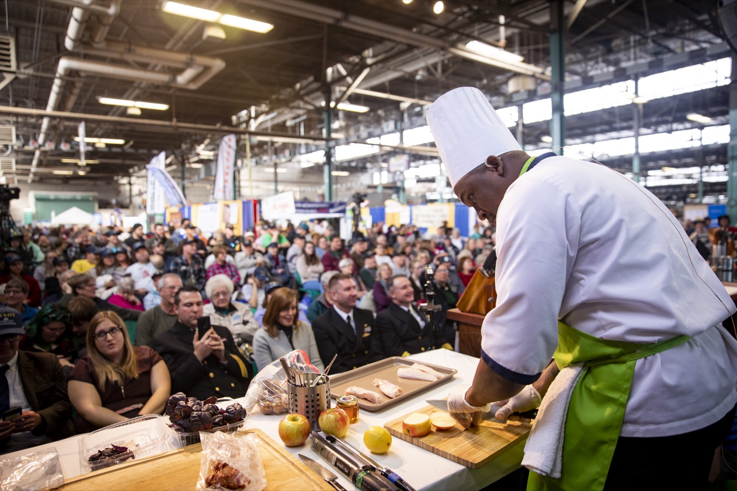"""<a href=""""http://filesource.abacast.com/commonwealthofpa/photo/17651_AGRIC_ARMY_NAVY_COOKOFF_CZ_06.jpg"""" target=""""_blank"""">⇣Download Photo<br></a>Culinary Specialist First Class Marlon ONeil Haughton prepares secret ingredients, including Pennsylvania apples, at the 2020 Army vs. Navy Cook-Off in Harrisburg on January 9, 2020."""