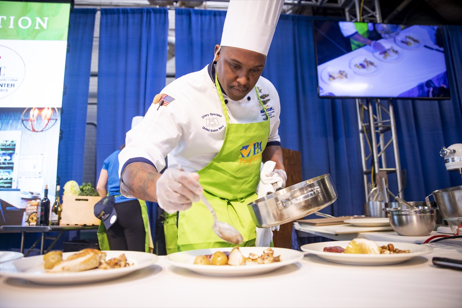 """<a href=""""http://filesource.abacast.com/commonwealthofpa/photo/17651_AGRIC_ARMY_NAVY_COOKOFF_CZ_12.jpg"""" target=""""_blank"""">⇣Download Photo<br></a>Culinary Specialist First Class Marlon ONeil Haughton plates his winning dish at the 2020 Army vs. Navy Cook-Off in Harrisburg on January 9, 2020."""