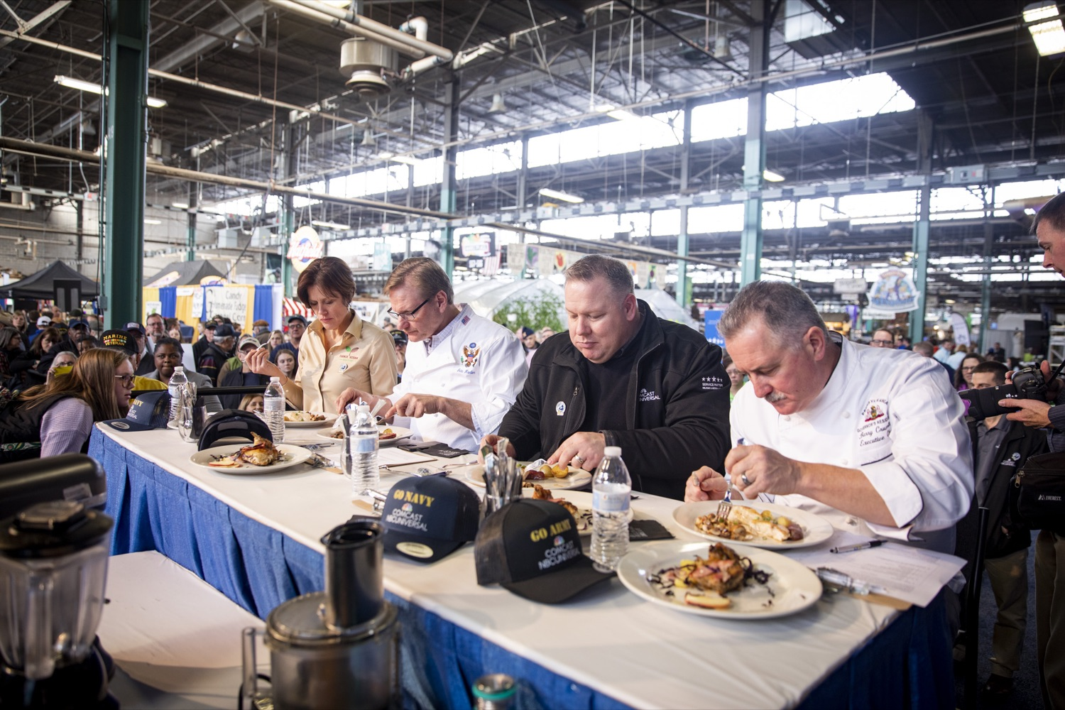 """<a href=""""http://filesource.abacast.com/commonwealthofpa/photo/17651_AGRIC_ARMY_NAVY_COOKOFF_CZ_14.jpg"""" target=""""_blank"""">⇣Download Photo<br></a>(From Left to Right) Judges Sarah Dachos, John Moeller, Gregory Magee Jr., and Barry Crumlich taste dishes from competitors at the 2020 Army vs. Navy Cook-Off in Harrisburg on January 9, 2020."""