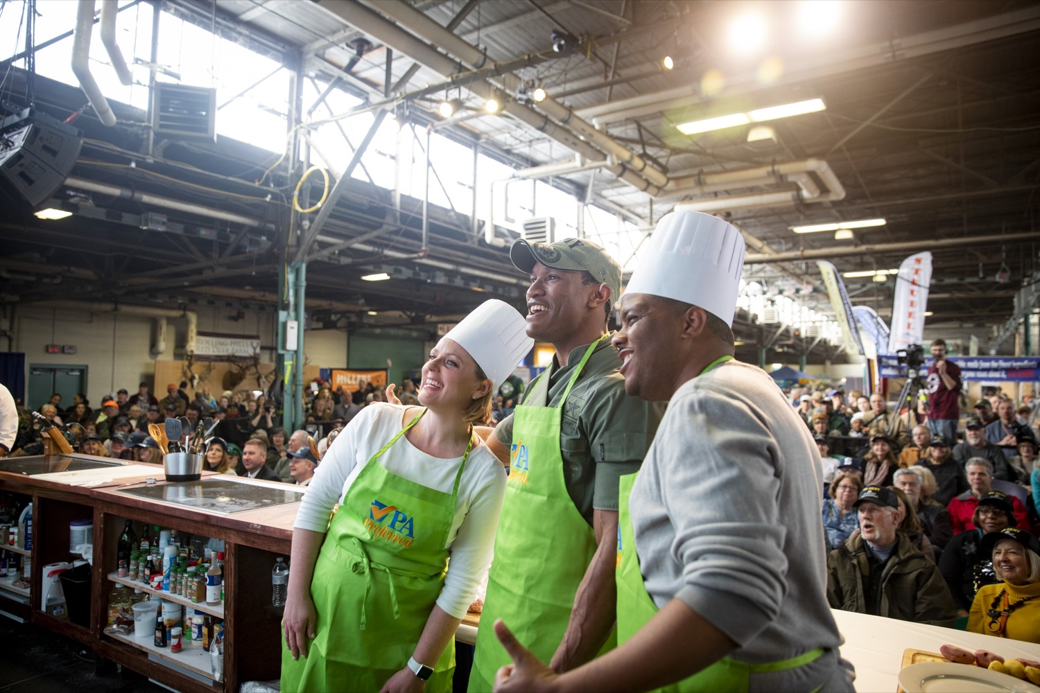 """<a href=""""http://filesource.abacast.com/commonwealthofpa/photo/17651_AGRIC_ARMY_NAVY_COOKOFF_CZ_15.jpg"""" target=""""_blank"""">⇣Download Photo<br></a>Sergeant Pete O. Linton poses with Sous Chefs Ali Lanyon and James Crumble of ABC27 News at the 2020 Army vs. Navy Cook-Off in Harrisburg on January 9, 2020."""