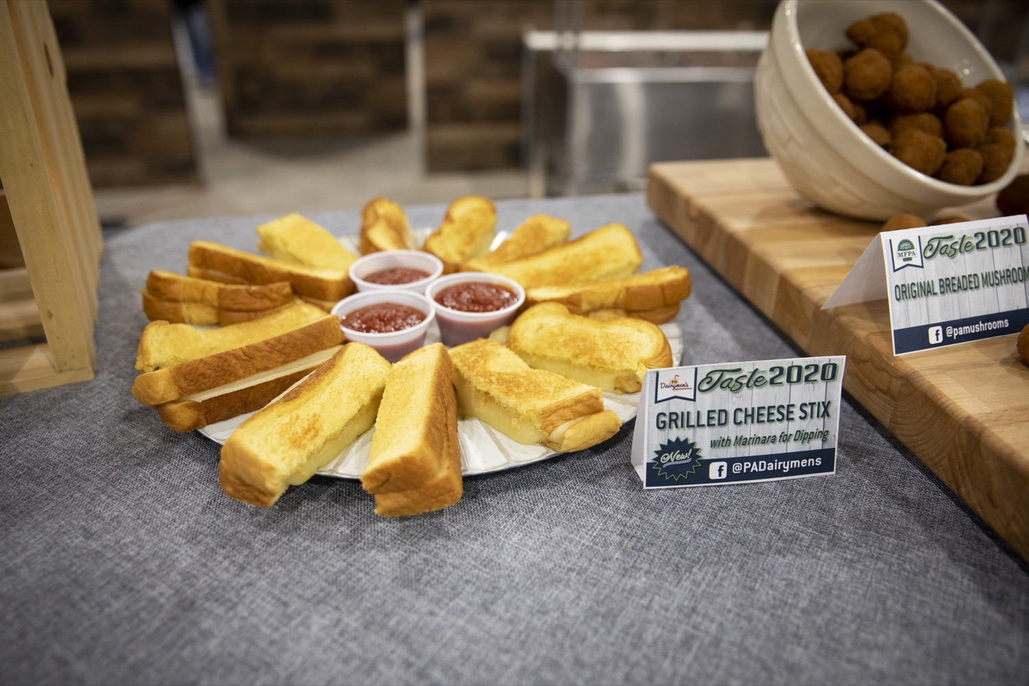 """<a href=""""http://filesource.abacast.com/commonwealthofpa/photo/17658_FARM_SHOW_FIRST_TASTE_CZ_04.JPG"""" target=""""_blank"""">⇣Download Photo<br></a>The PA Dairymens Association introduces grilled cheese stix with marinara dipping sauce at the Pennsylvania Farm Show Food Court in Harrisburg on January 2, 2020."""
