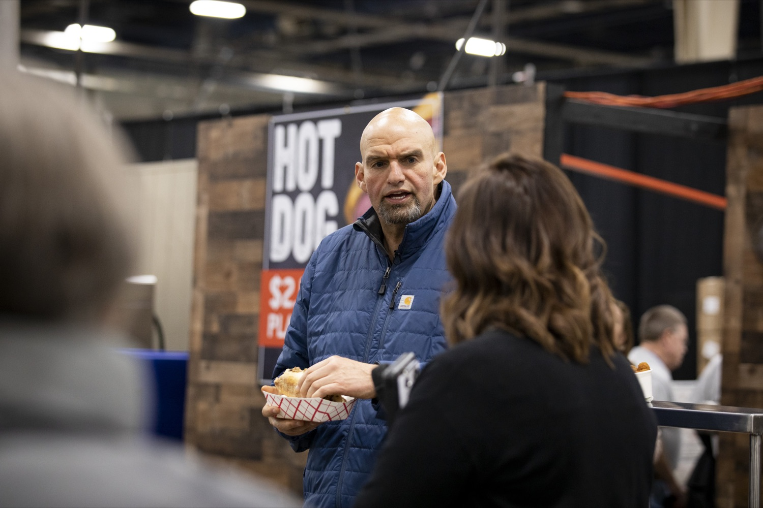 """<a href=""""http://filesource.abacast.com/commonwealthofpa/photo/17658_FARM_SHOW_FIRST_TASTE_CZ_12.JPG"""" target=""""_blank"""">⇣Download Photo<br></a>Lt. Governor John Fetterman samples a Philly port sandwich from the Mushroom Farmers of Pennsylvania at the Pennsylvania Farm Show Food Court in Harrisburg on January 2, 2020."""