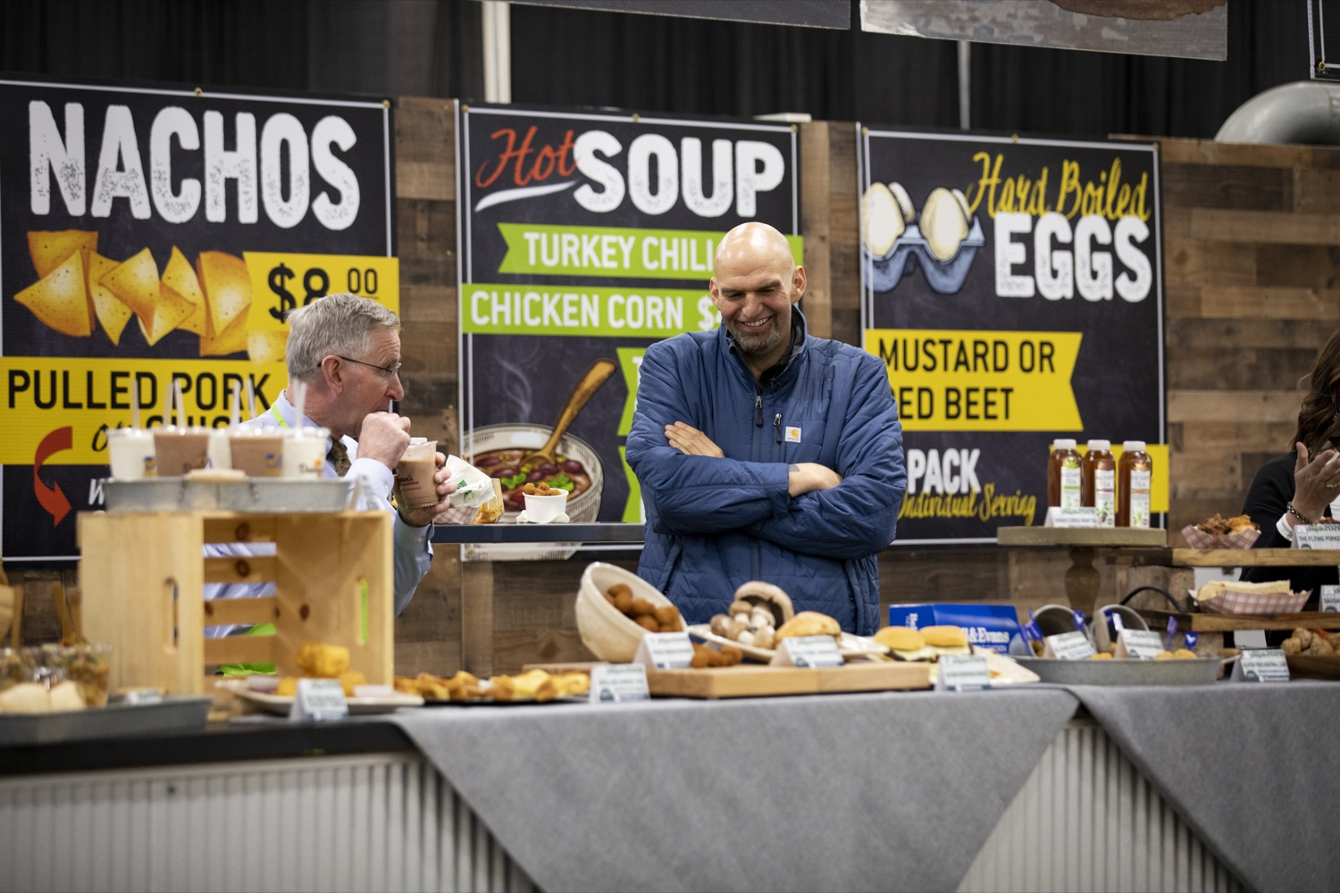 """<a href=""""http://filesource.abacast.com/commonwealthofpa/photo/17658_FARM_SHOW_FIRST_TASTE_CZ_14.JPG"""" target=""""_blank"""">⇣Download Photo<br></a>Lt. Governor John Fetterman and Secretary of Agriculture Russell Redding preview new items on the menu in the 2020 Farm Show Food Court in Harrisburg on January 2, 2020."""